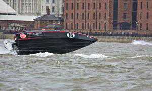 P150 Class boat 'Black Magic' during a race on day two of the P1 Superstock Liverpool Grand Prix of the Sea, River Mersey, England, September 2011. - Graham Brazendale