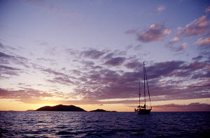Yacht at sunset. All non-editorial uses must be cleared individually. - Sea & See