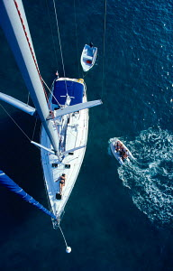 Cruising yacht viewed from top of mast. All non-editorial uses must be cleared individually.  -  Sea & See