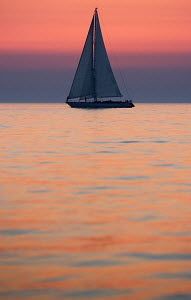 Cruising yacht 'Pegasus' at dusk near to Portoroz, Slovenia, July 2007. For editorial use only.  -  Sea & See