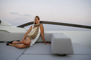 Woman relaxing on board Peri superyacht Quantum 29, Antalya, Turkey, July 2007.  For editorial use only.  -  Sea & See