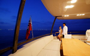 Couple looking out to sea from Peri superyacht Quantum 29, Antalya, Turkey, July 2007.  For editorial use only.  -  Sea & See