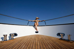 Woman relaxing on bow of Peri superyacht Quantum 29, Antalya, Turkey, July 2007. For editorial use only.  -  Sea & See