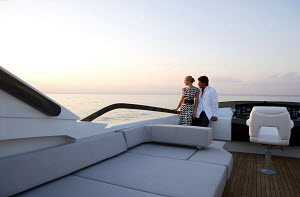 Couple looking out to sea on board Peri superyacht Quantum 29, Antalya, Turkey, July 2007.  For editorial use only.  -  Sea & See