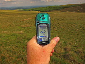 Garmin being used to follow transect during bird survey work, Kelburn North Ayrshire Scotland UK June 2010  -  Robin Chittenden