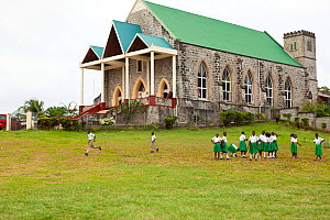 School children playing by Catholic church, Pearls, Grenada, Caribbean, West-Indies, May 2009. No release.  -  Michele Westmorland