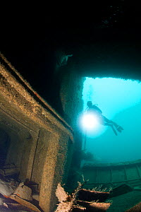 Scuba diving on the cargo ship wreck, 'Hema I', South Island, Grenada, West-Indies, Caribbean. Model released. - Michele Westmorland