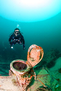 Scuba diver exploring wreck of small yacht sunk in a hurricane. Grenada, West-Indies, Caribbean. Model released. - Michele Westmorland
