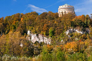 Autumn colours and limestone rocks in the Weltenburger Enge nature reserve near Kelheim with the Liberation Hall of King Ludwig I. Bavaria, Germany, October 2010.  -  Martin Gabriel