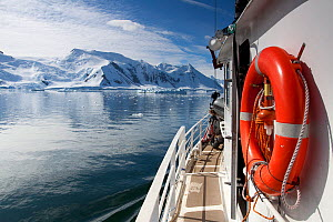 The 'Golden Fleece' (base ship for BBC film crew) passing up the coast of the Antarctic Peninsula, Antarctica, January 2009, Taken on location for BBC Frozen Planet series  -  Kathryn Jeffs