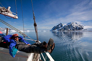 Dr Robert (Bob) Pitman, from US National Marine Fisheries Service, scientific advisor, relaxing on board the 'Golden Fleece' prior to searching for whales, Antarctic Peninsula, Antarctica, January 200...  -  Kathryn Jeffs