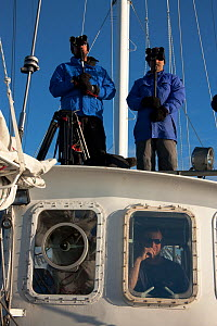 Dr Robert (Bob) Pitman and Dr John Durban, scientific advisors, watching for Killer whales (Orcinus orca) on board the 'Golden Fleece', off Antarctic Peninsula, Antarctica, January 2009, Taken on loca...  -  Kathryn Jeffs