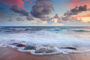 Waves washing up a beach on the Baltic coast of Estonia under sunset lit clouds. Europe, August 2011. - Sven Zacek