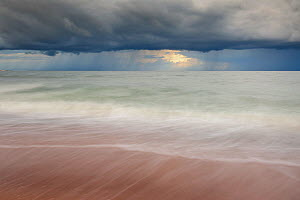 Waves washing up a beach under dark clouds. Hiiumaa Island, Estonia, Europe, August 2011. - Sven Zacek