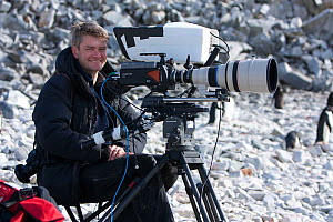 Wildlife Cameraman, John Aitchison, on location, filming Adelie penguins, Antarctica, February 2009, Taken on location for BBC Frozen Planet series  -  Kathryn Jeffs