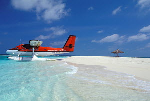 Seaplane in the shallows on beach at Palm Beach Island Resort, Maldives. - Sea & See