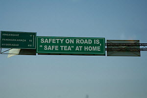 Amusing road safety sign above road on road to Hyderabab, capital of Andhra Pradesh, India  -  Michael W. Richards