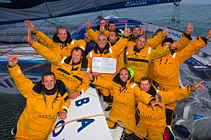 """Crew of """"Banque Populaire V"""" celebrating breaking the Jules Verne Trophy record in the time of 45 days, 13 hours, 42 minutes, and 53 seconds, beating the record previously held by """"Groupama 3"""". Brest,...  -  Benoit Stichelbaut"""