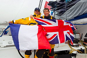 """Skipper Loick Peyron and British team member Brian Thompson celebrating breaking the Jules Verne Trophy record in the time of 45 days, 13 hours, 42 minutes, and 53 seconds on board """"Banque Populaire V...  -  Benoit Stichelbaut"""