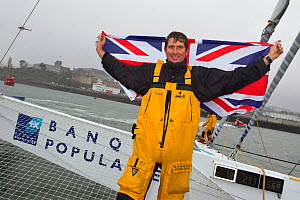 """British team member Brian Thompson celebrating breaking the Jules Verne Trophy record in the time of 45 days, 13 hours, 42 minutes, and 53 seconds on board """"Banque Populaire V"""", beating the record pre...  -  Benoit Stichelbaut"""