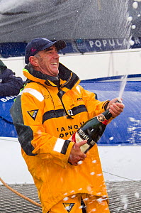 """Skipper Loick Peyron celebrating breaking the Jules Verne Trophy record in the time of 45 days, 13 hours, 42 minutes, and 53 seconds on board """"Banque Populaire V"""", beating the record previously held b...  -  Benoit Stichelbaut"""