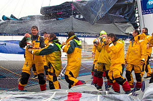 """Crew of """"Banque Populaire V"""" celebrating breaking the Jules Verne Trophy record in the time of 45 days, 13 hours, 42 minutes, and 53 seconds, beating the record previously held by Groupama 3. Brest, F...  -  Benoit Stichelbaut"""