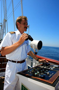 Captain navigating on board cruise tall ship 'Star Clipper', Spain, May 2007. For editorial use only. - Sea & See