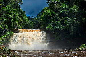 Maliau Falls (6th of 7 tiers) on the Maliau River with a brooding storm in the sky. Centre of Maliau Basin, Sabah's 'Lost World', Borneo. - Nick Garbutt