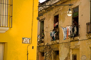 Building with people hanging out their washing, in Old Havana, UNESCO World Heritage Site, Cuba, Caribbean, 2011  -  Pete Oxford