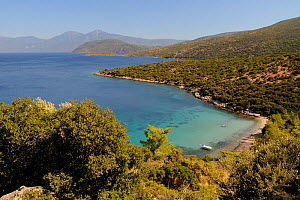 Mikri Laka beach with the southeast tip of Samos and Mount Mycale in Turkey's Dilek Peninsula National Park in the background, east coast of Samos, August 2011. - Nick Upton