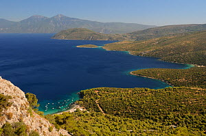 Mourtia beach and bay with the southeast tip of Samos and Mount Mycale in Turkey's Dilek Peninsula National Park in the background, east coast of Samos, August 2011. - Nick Upton