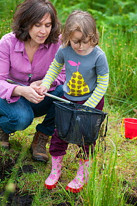 Mother and daughter pond dipping in rhyne, visiting the Westhay Nature Reserve, Somerset Levels,  UK, June 2011, model released  -  Paul Harris / 2020VISION