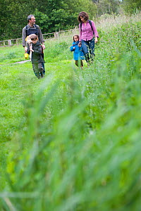 Family going pond dipping on visit to the Westhay Nature Reserve, Somerset Levels, UK, June 2011, model released  -  Paul Harris / 2020VISION