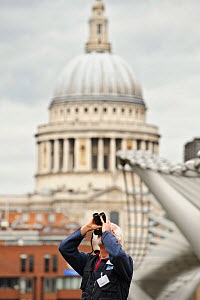 RSPB volunteer watches peregrine falcons with St Paul's Cathedral in background, RSPB 'Date With Nature Event' for learning about urban Peregrine falcon, Tate Modern, South Bank, London, UK, September...  -  Terry Whittaker / 2020VISION
