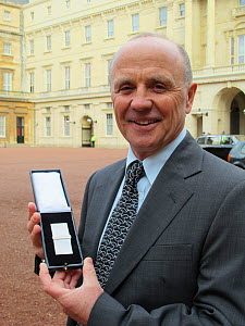 Doug Allan receives the second bar of The Polar Medal at Buckingham Palace, London, UK, 26th January 2012. Doug received his first Polar Medal in 1983 for his work with the British Antarctic Survey. - Sue Flood