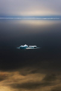 Iceberg in calm arctic seas at 80 degrees north. Svalbard, September.  -  Ole Jorgen Liodden