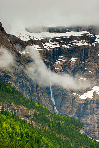 Gavarnie Falls, cascade down through the clouds from near the top of the mountain, Pyrenees, France, June. 2011.  -  Inaki Relanzon