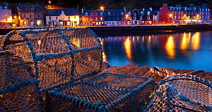 Lobster pots on harbourside at night, Tobermory harbour, Isle of Mull, Scotland.  -  Alex Hyde