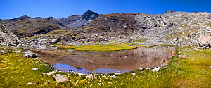 Mountain lake with Pic de Campbieil in the background, digitally stitched panorama, Hautes-Pyrenees, France, August.  -  Alex Hyde