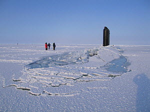 Submarine surfacing through ice sheet. Beaufort Sea, Alaska, USA, March. Freeze frame book plate page 131.  -  Doug Allan