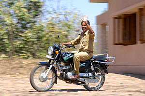 Forest park guard on motorbike, Pench National Park, Madhya Pradesh, India, 2006  -  Michael W. Richards
