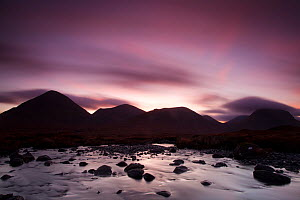 Silhouettes of the Red Cullin at dawn, with stream in the foreground, Isle of Skye, Inner Hebrides, Scotland, UK, November 2010 - Mark Hamblin / 2020VISION
