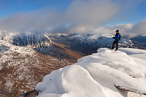 Hillwalker admiring the view from the summit of Tom na Gruagaich in winter, Beinn Alligin, Torridon, Scotland, UK, February 2010 Model Released. 2020VISION Exhibition. 2020VISION Book Plate. Did you k... - Mark Hamblin / 2020VISION