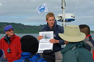 Sea Life Surveys guide briefing tourists on whale identification on board Sula Beag, a dedicated wildlife watching boat, Inner Hebrides, Scotland, UK, July 2011 - Chris Gomersall / 2020VISION