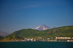 The port of Petropavlovsk-Kamchatskiy in Avacha Bay, with Avachinsky Volcano on the horizon. Southern Kamchatka Peninsula, Russian Far East, July 2009. - Jenny E. Ross