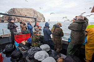 Tourists on boat trip to Bass Rock to photograph seabirds, Firth of Forth, North Berwick, Scotland, UK, July 2010  -  Peter Cairns / 2020VISION
