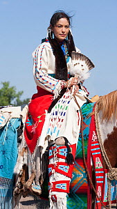 A traditionally dressed Crow Indian woman rides a paint horse during the parade, at the annual Indian Crow Fair, at Crow Agency, near Billings, Montana, USA, August 2011  -  Kristel Richard