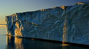 Waterfall and ice cliff catching evening light. Austfonna Polar Ice Cap, Svalbard, Norway, August 2011.  -  Andy Rouse