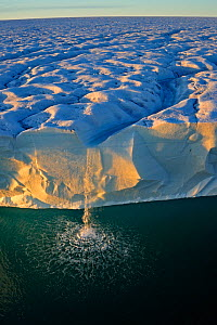 Waterfall from ice cliffs with ice-cap stretching into the distance. Austfonna Polar Ice Cap, Svalbard, Norway, August 2011.  -  Andy Rouse