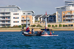 Marshalls attending to small dinghies, Poole, Dorset, England, October 2010.  -  David Woodfall